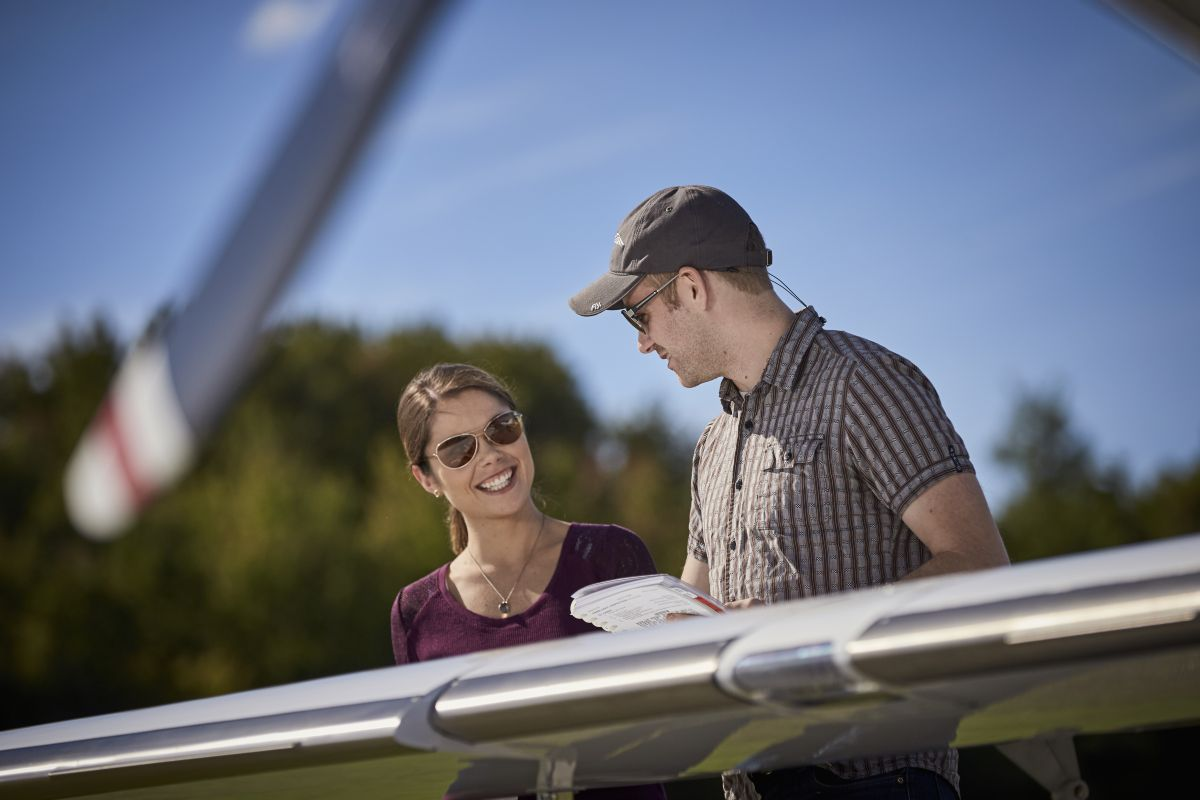 Image of two people looking at aircraft