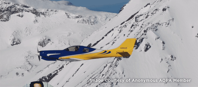 Image Courtesy of Anonymous AOPA Member. Aircraft flying past snow-covered mountain.
